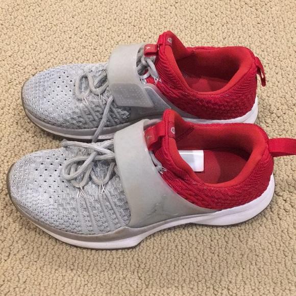 Men's Nike Jordan gray and red low tops
